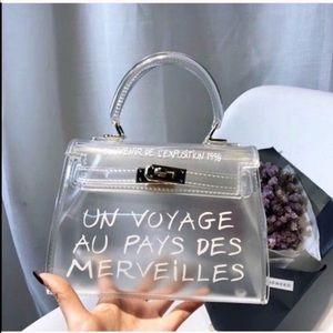 Handbags - Clear Un Voyage Au Pay de Merveilles Bag